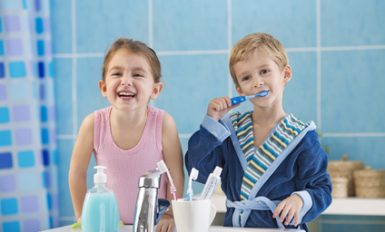 Children brushing teeth in the bathroom.